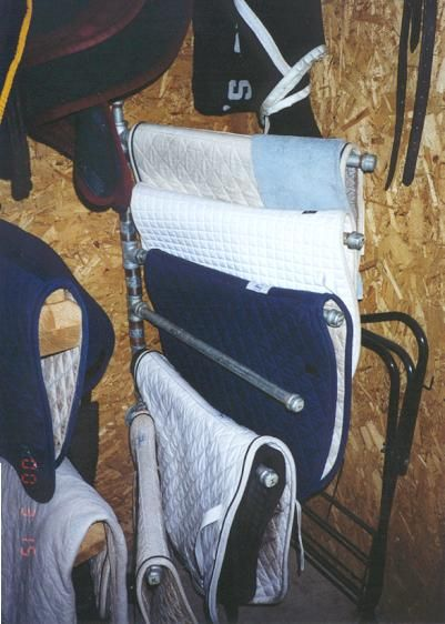"""Saddle Pad Rack made with 3/4"""" galvanized plumbing pipe... very customizable with how many """"arms"""" you have"""