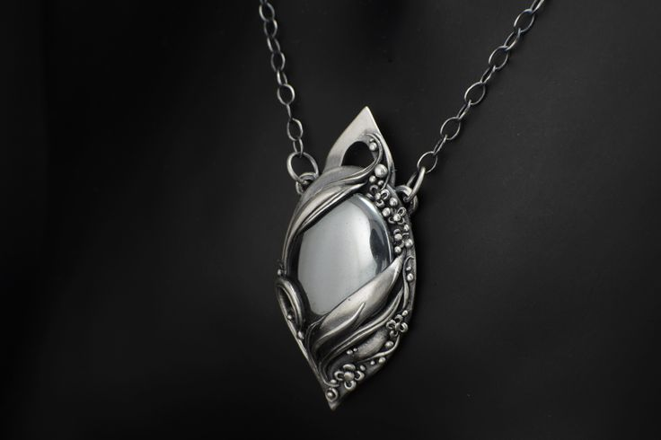 Equilibrium - Fine Silver / Hematite  Fine silver necklace pendant with natural Canadian hematite. In this piece, the natural balance of all things is represented with the marriage of the fine silver with the hematite to produce a symbolic representation of the Equilibrium of love.