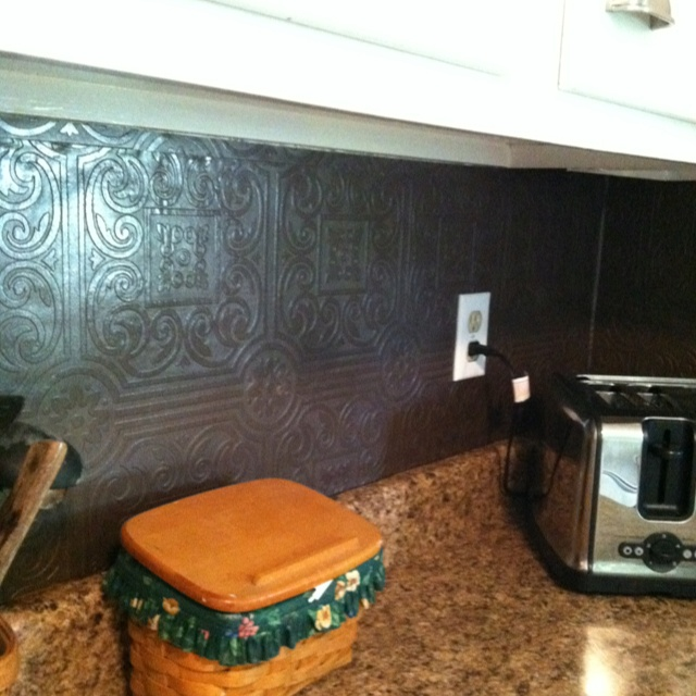 Faux Tin Wallpaper Painted With Rubbed Bronze Spray Paint For Backsplash!  Plastic Tin Tiles In