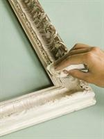 Paint chalk paint on a gold frame and then wipe it off - try this on an old gold frame I have.