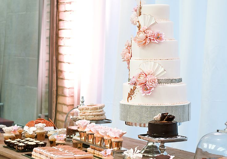 Beautiful soft pink floral wedding cake and dessert station