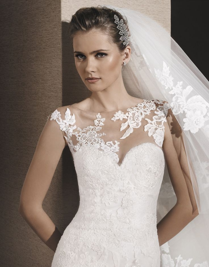 ROBIN // This classic mermaid gown can be ordered with or without a jacket that creates an illusion lace neckline