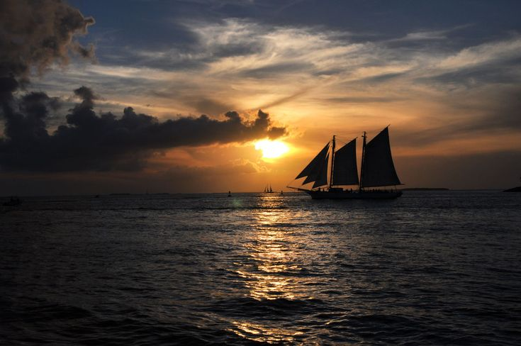 sunset, sea, sky, cloud - sky, water, nautical vessel, beauty in nature, scenics, tranquility, nature, sailboat, sun, transportation, sailing, waterfront, tranquil scene, silhouette, mode of transport, horizon over water, outdoors, no people, mast, sunlight, sailing ship, day