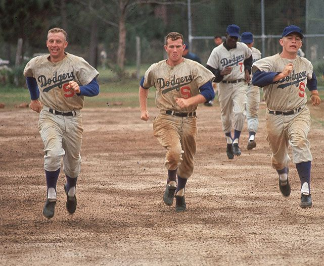Members of the Los Angeles Dodgers run a wind sprint during spring training in March 1965. Six months later, the team would win the World Series. Will the 2012 Dodgers, bolstered by the recent acquisitions of Adrian Gonzalez, Hanley Ramirez and Josh Beckett, win a championship in October? (James Drake/SI)