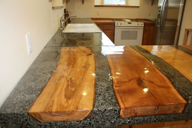 Concrete countertop with split logs moulded in place