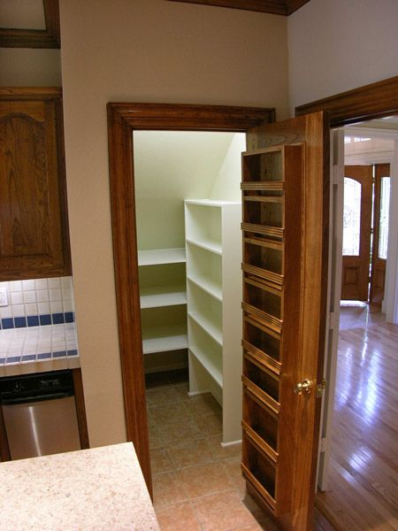 Idea for my pantry. It is small and under the stairs, shelves on the door would help.