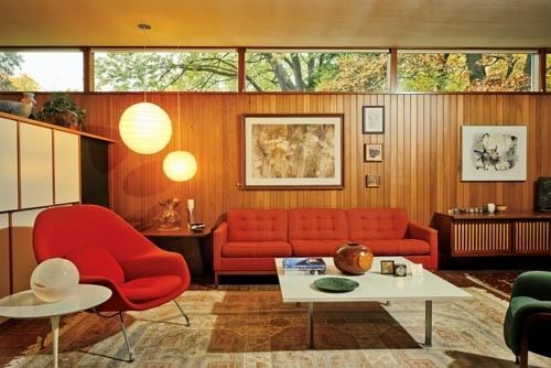 Nice modernist house showcases beautiful furniture:  a red womb chair on the left.