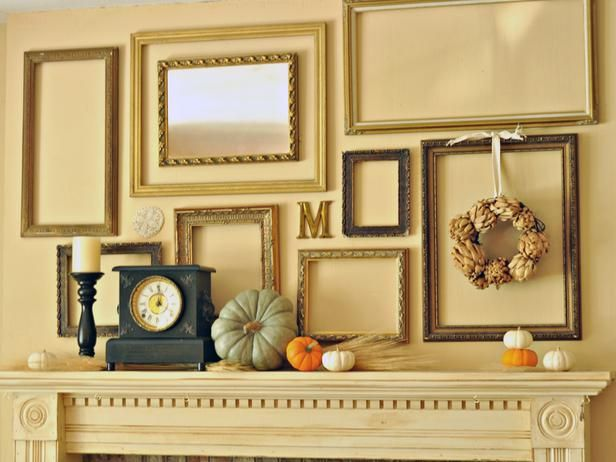Pumpkins and sheaths of wheat, backed by a display of open frames, have a decidedly fall feel with the addition of a dried artichoke wreath and family name initial. Design by Cailan Matthews