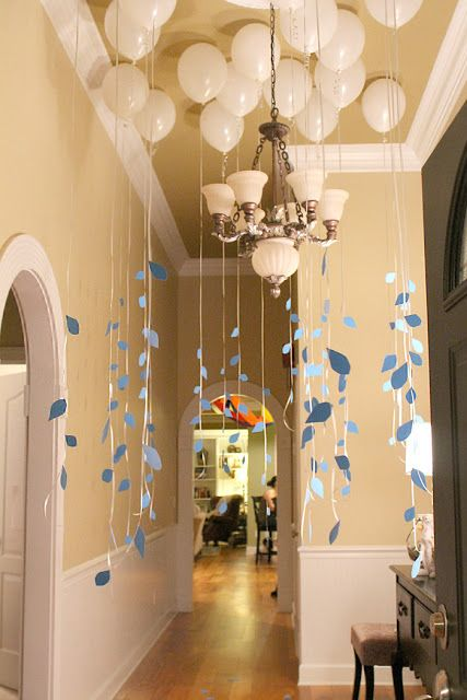 Rent a helium tank and fill up white balloon to create this look for your baby shower!