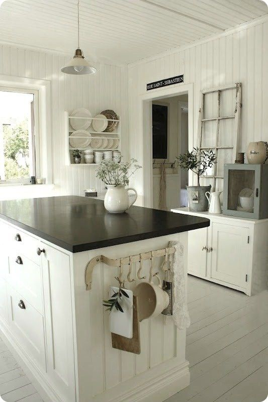 Farmhouse - love the side rack and the bead board used to highlight ends of cabinets.
