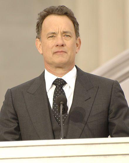 Hanks standing at a podium