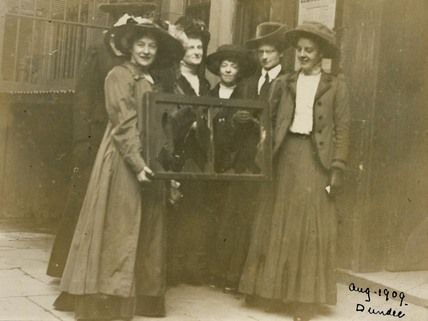 This picture shows five suffragettes holding a broken window pane in 1912, with Adela Pankhurst on the far left. From 1911 window smashing became an official tactic of the WSPU. Women who took part in this form of campaigning were quickly arrested and therefore not exposed to confrontational struggles with the police as had occurred on Black Friday: Arrested, Broken Window, Adela Pankhurst, The Woman, Suffragette Hold, Window Panes, 1911 Window, Window Smash, Window Frames