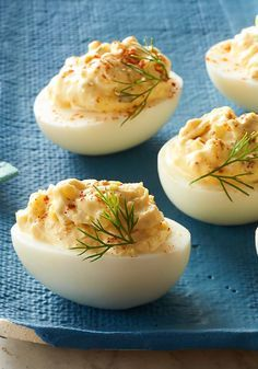 """The Best Deviled Eggs – When we say """"the best"""", we mean """"the best""""! This appetizer recipe takes just 15 minutes to make, complete with a dash of cayenne pepper that makes them exceptionally devilish. Garnish with fresh dill for an impressive finish that's sure to wow your holiday party guests. We suggest enjoying one before serving because these won't last long on the Christmas buffet table."""