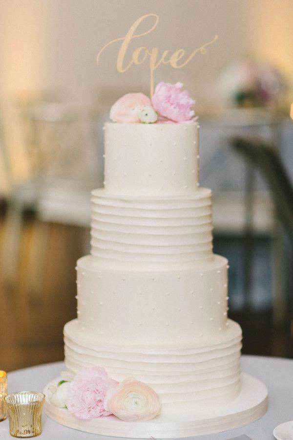 "Laser cut ""love"" cake topper: http://www.stylemepretty.com/washington-dc-weddings/2016/07/01/pretty-pink-peonies-take-center-stage-at-this-dc-wedding/ | Photography: Elizabeth Fogarty - http://www.elizabethfogartyphotography.com/"