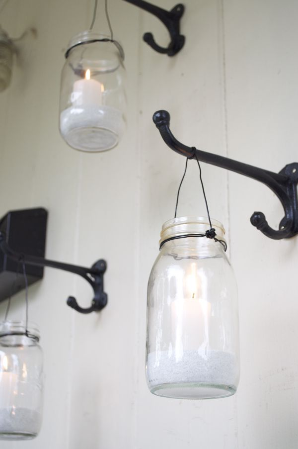 Canning jars with candles hung from hangers