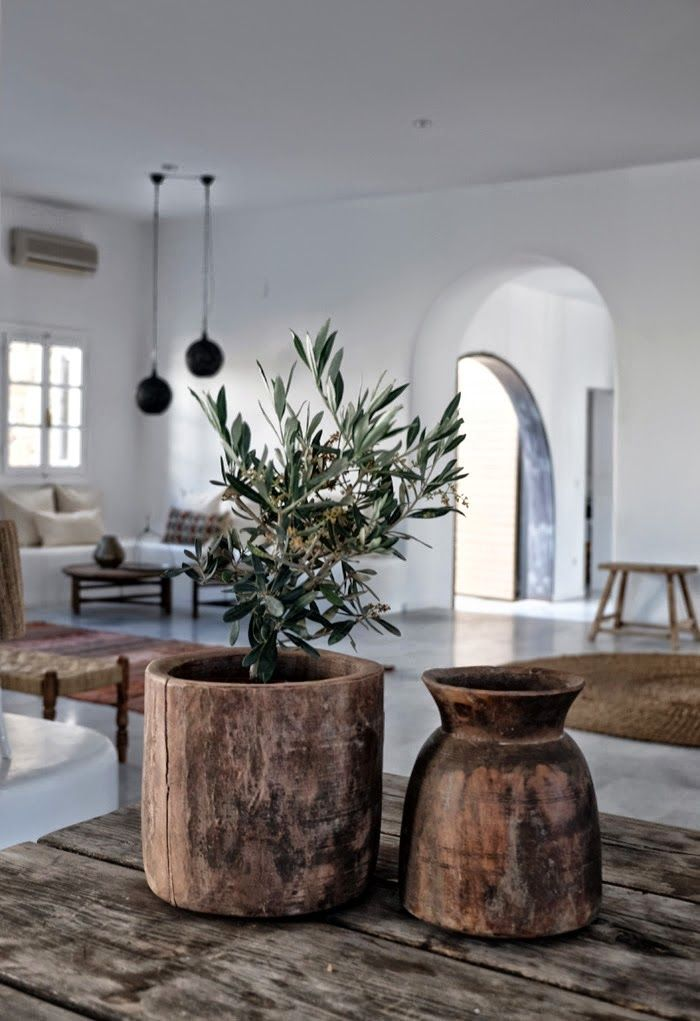 Olive tree, Bohemian lifestyle. Love the combination with earth colors, wood & plain white.