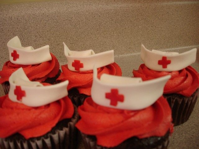 Nurses hats are made from Marshmallow fondant. They were so easy!