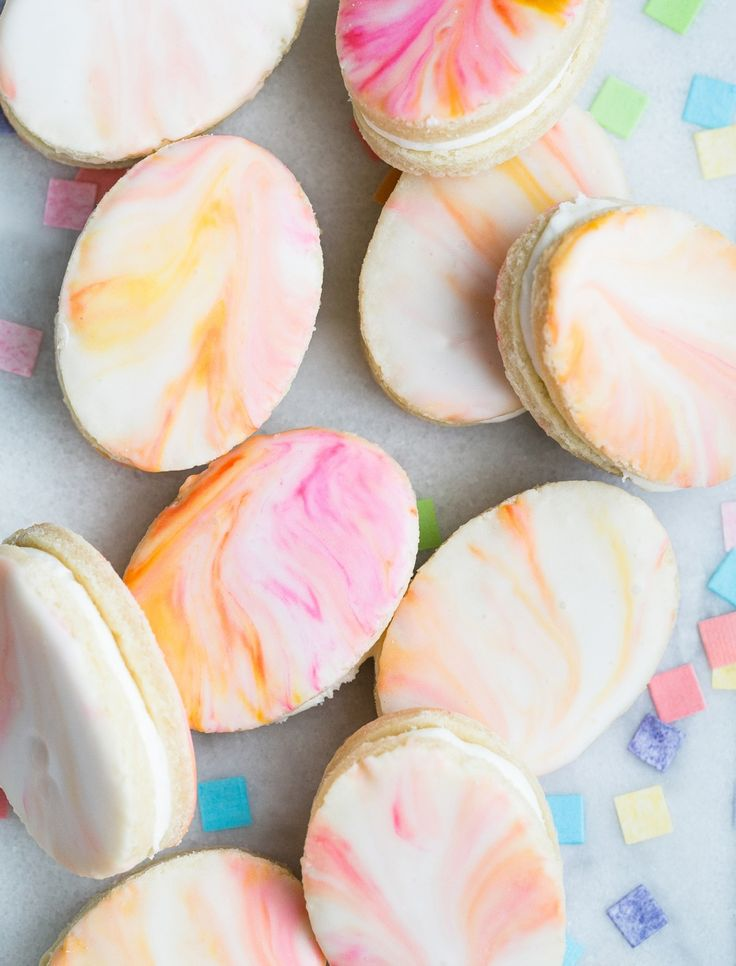 Marble icing sugar cookie sandwiches in the shape of Easter eggs