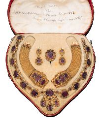 A SUITE OF LATE GEORGIAN AMETHYST JEWELLERY  Comprising a necklace, the front section of girandole motif to the oval-cut amethyst necklace, each in a two-coloured floral surround; a pair of bracelets, a brooch and a pair of ear-pendants en suite, first quarter of 19th century, necklace 46.5 cm., bracelets 14.0 and 15.5 cm., in its original tooled red leather fitted case