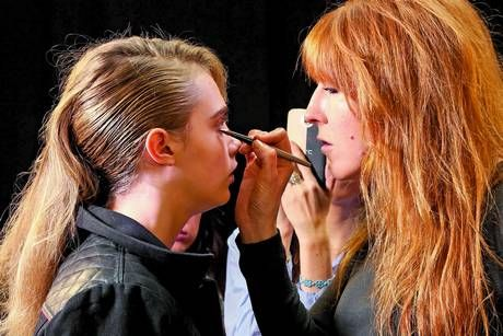 Make-up maestro: Cara Delevingne having make-up applied by Charlotte Tilbury (Picture: Rex)