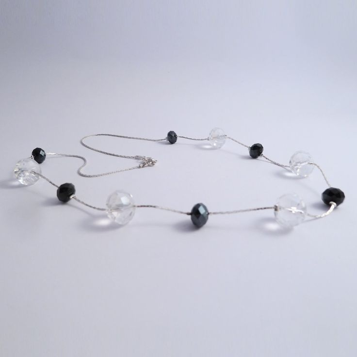 Swarovski elements floating necklace with black and clear beads
