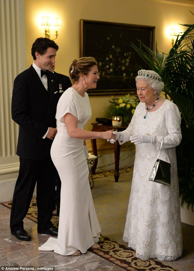 Her Majesty is all smiles as she greets Canadian Prime Minister Justin Trudeau and his television host wife Sophie Grégoire