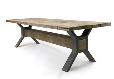 The ultimate rustic industrial dining table. Sturdy steel X trestles and a rustic solid square beam support a reclaimed pine top with a wipeable, waxed finish. Free yourself from worrying about your t