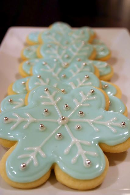 Stuff By Stace: Snowflake Sugar Cookies Icing Recipe...I like that the snowflakes were made using flower cookie cutter!