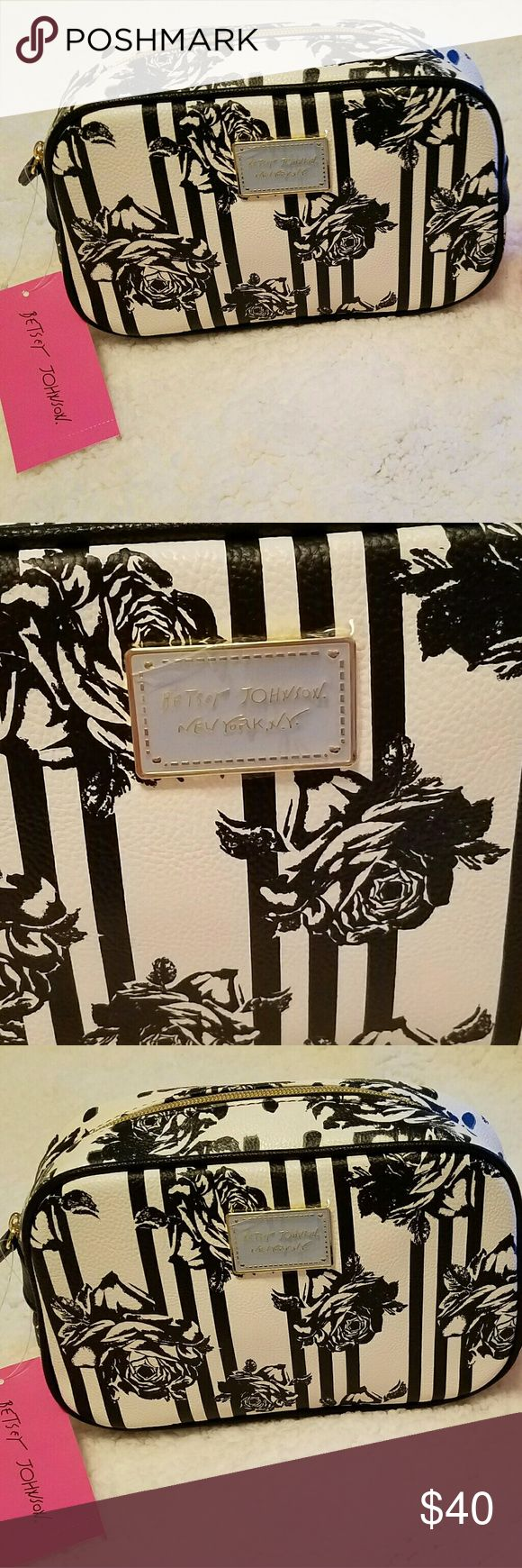 "NWT- BETSEY JOHNSON NY NY STYLE FLORAL DESIGN NWT- BETSEY JOHNSON NEW YORK NY STYLE FLORAL DESIGN COSMETIC BAG.  BEAUTIFUL DESIGN BLACK FLORAL PRINT AND EXTRA OPENING IN BACK   ZIPPER ENCLOSURE, SUPER CUTE LINING  APPROXIMATE SIZE 9""W X 5""H X 3.5""W  🌹NWT-BRAND NEW WITH TAGS - NEVER USED 🌹100% AUTHENTIC 🌹SAME DAY SHIPPING 🌹NO TRADES  🚫PLEASE READ MY CLOSET RULES AND FOLLOW PLEASE NO RUDE COMMENTS LETS ALL BE RESPECTFUL TOWARDS ONE ANOTHER 😊  💋www.shopaprilsboutique.com💋 Betsey Johnson…"