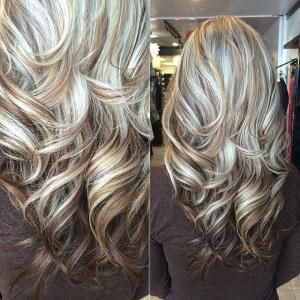 long layered haircut in light blonde highlights with brown lowlights by Tabitha86