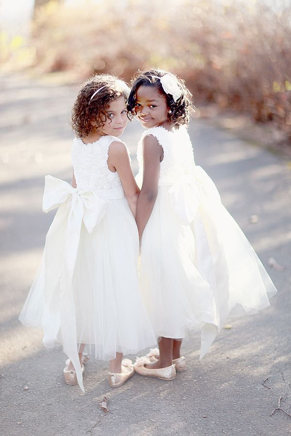 precious flower girls & gorgeous dresses!  love the big bows :)