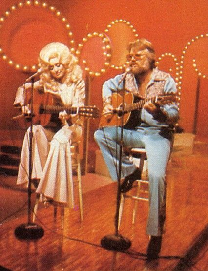Dolly Parton and Kenny Rogers  http://abcnews.go.com/GMA/video/kenny-rogers-dolly-parton-reunite-duet-20287552