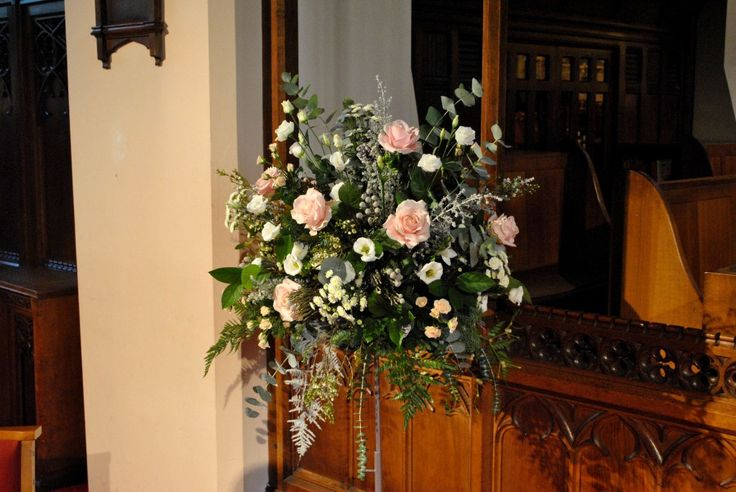 Large floral arrangement including roses, lisianthus, brunia and eucalyptus