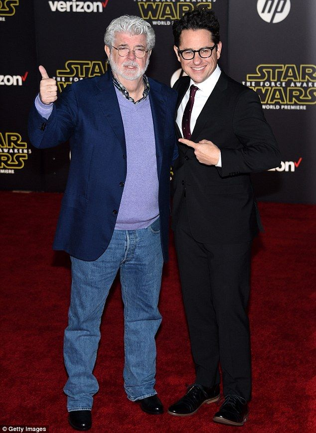 The directors: Star Wars creator George Lucas was embraced by Star Wars: The Force Awakens director JJ Abrams on Monday at the film's premiere in Hollywood