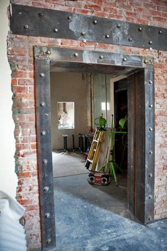 Brick and steel Opening walk through for reception area to water cooler