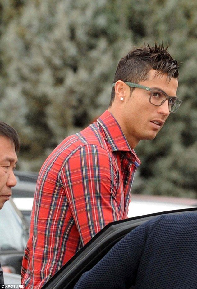 He's a glass player: Cristiano Ronaldo dons spectacles to pick up son from school in Madrid
