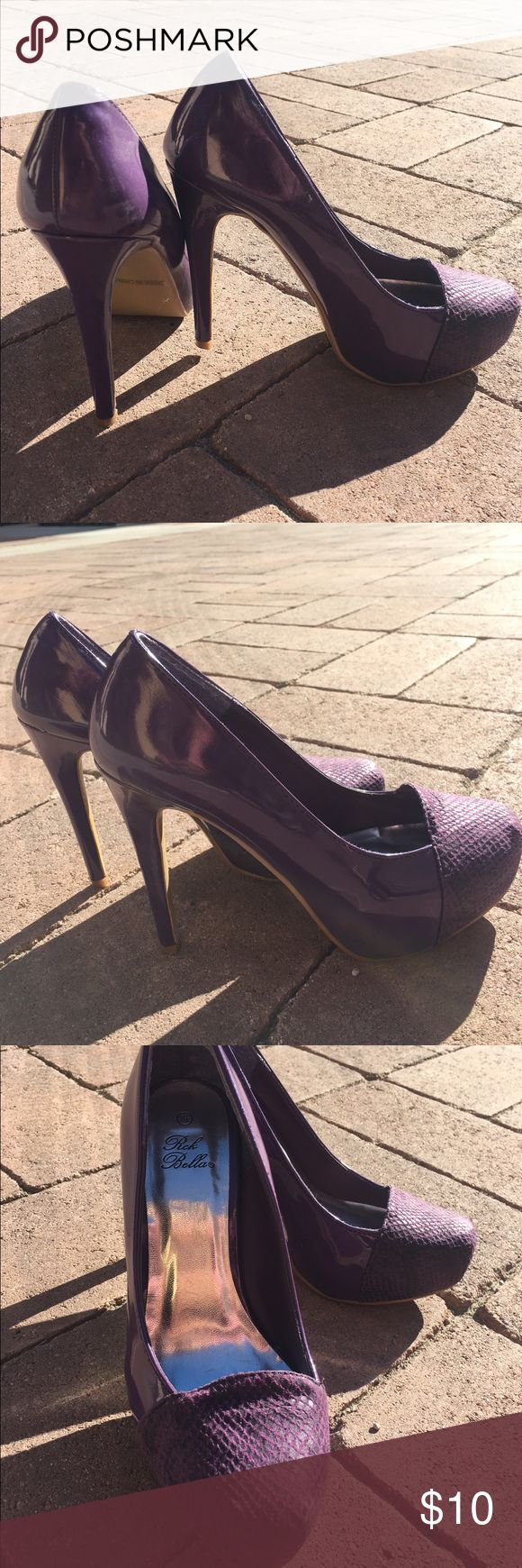 Royal Purple front print high heels If you're a bold kind of girl these shoes are so for you, worn twice but got many compliments each time. They are a total statement piece that can be added to a number of outfits. The front has a subtle animal print in black that adds a really nice flirtatious touch:) Shoes Heels