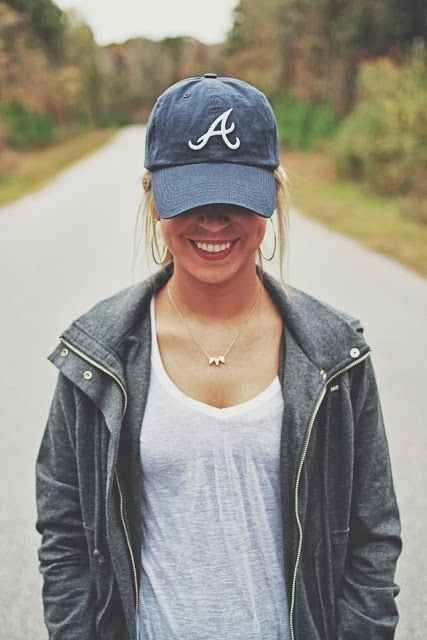 baseball hat + grey sweater