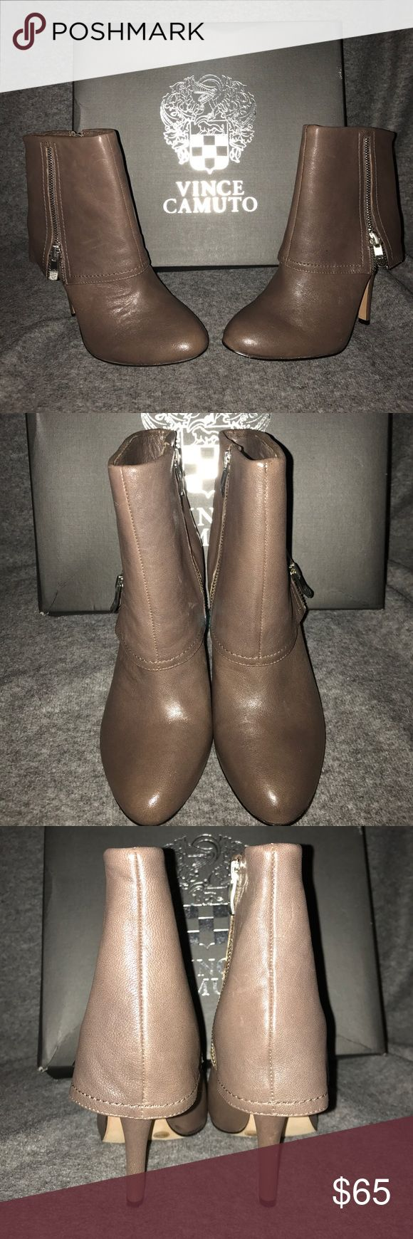 Vince Camuto Boots NIB A beautiful brand new pair of women's size 6 Vince Camuto leather ankle boots they are a tannish neutral color with zippers on both sides but the zippers on the inside are the only ones that zip up and down...they have a heel length of 4 inches and the shoe itself is 8.5 inches tall they are in excellent condition still in the box and come from a smoke and pet free house Vince Camuto Shoes Ankle Boots & Booties