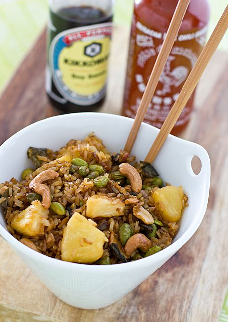 This baked fried rice recipe uses brown rice instead of white. With added pineapple, cashews, edamame, and sriracha, it makes a great, easy meal!