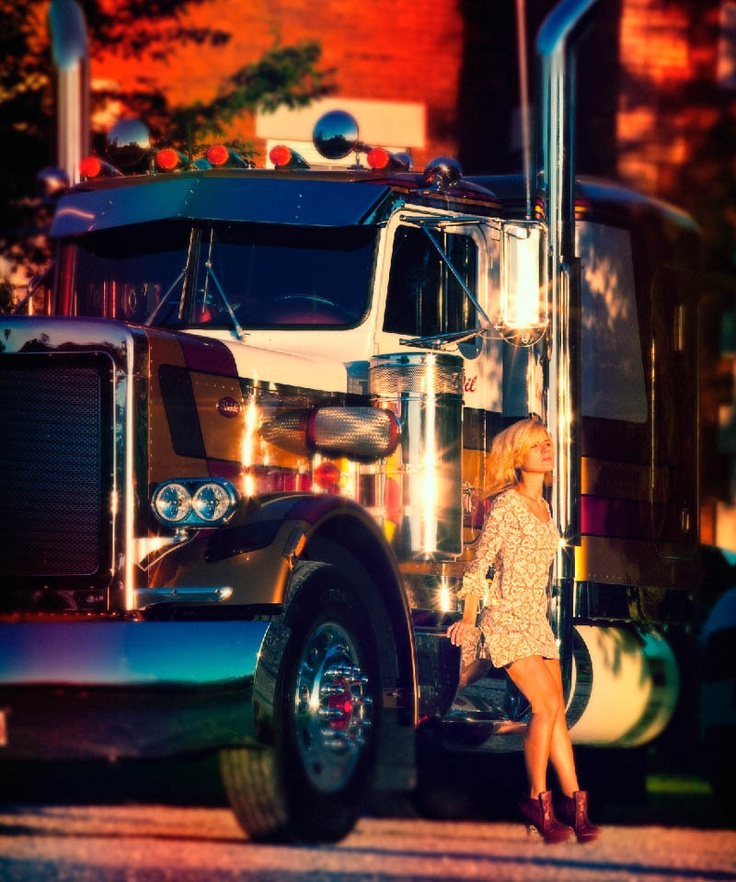 Girls posing with big trucks