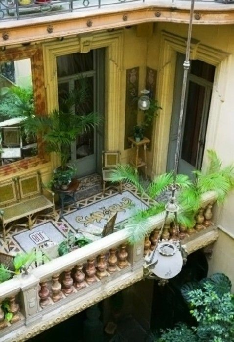 balcony - mosaic, french doors - wow, I'd love to see what this apartment looks like on the inside!