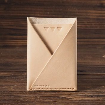 The Card Wallet is constructed out of two single piece of vegetable tanned leather.   Two-pocket card holder. For those that carry multiple cards and some cash.   It features one pocket for cash and o