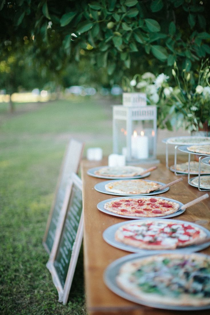 Pizza is casual, fun, and unexpected :)Wedding Food -- #Pizza Buffet!  See the wedding on SMP: http://www.StyleMePretty.com/2014/02/05/casual-walnut-orchard-wedding/ Abi Q Photography