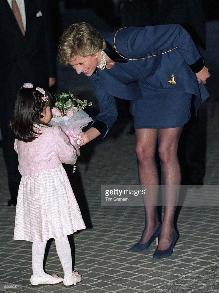 Young Japanese girl presenting flowers to Princess Diana At The Red Cross Headquarters In Tokyo, Japan.