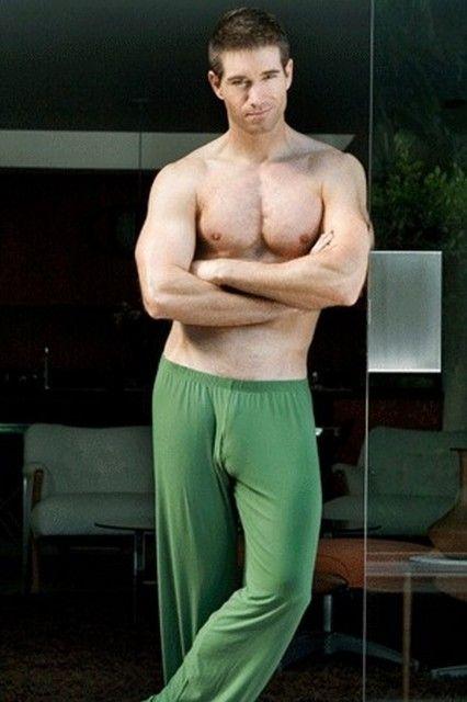 Shirtless Hunk Wearing Green Lounge Pants That Cling To