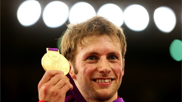 Gold medallist Jason Kenny of Great Britain celebrates during the medal ceremony for the Men's Sprint Track Cycling Final on Day 10 of the London 2012 Olympic Games at Velodrome