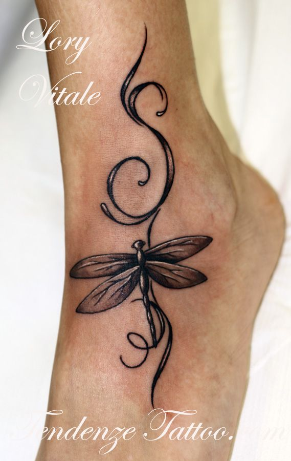 Hmm this makes my little dragonfly doodle tat look pretty ...