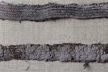 "Textile fragment from Birka grave 886. The Historiska museet labels this as ""tablet weaving"" (brickvävda), but it looks more like some kind of braided wire trim to me."