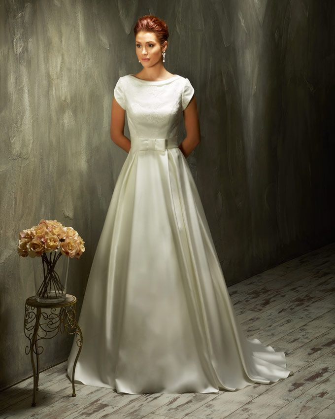 Dress: 70438 Available Colors: Ivory & White Material: Lace/Satin Sizes: EU 32-64 UK 6-38 USA 2-34